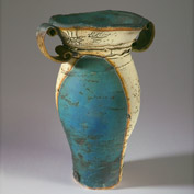 Blue distorted vase with scroll handles 16cm high