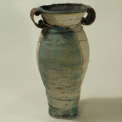 Pale blue distorted vase with scroll handles 16cm high